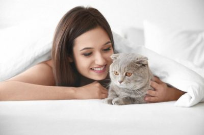 bigstock-Young-woman-with-cute-pet-cat-2254571711